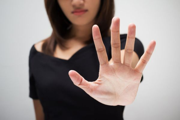 37067597 - young woman showing her denial with no on her hand